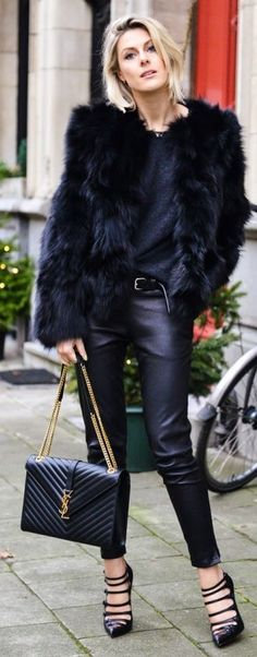 Chic all black outfit. Love the faux fur jacket and leather jeans.
