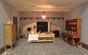 Georgian dolls house interior view of kitchen.