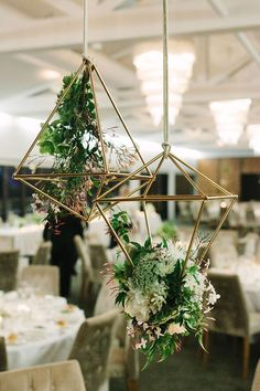 Suspended Floral Geo Shapes As Wedding Decor ~ white blooms and jasmine vine fill these shapes by Blooms by Bethan
