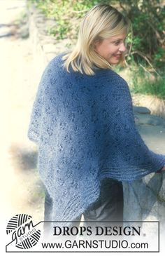 """Triangular DROPS shawl in """"Vivaldi"""" with lace pattern.  Free pattern by DROPS Design."""