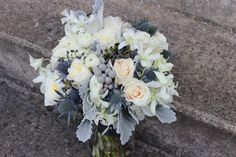 Navy blue and gray silver bridal bouquet wedding flowers  Www.sophisticatedfloral.com Dusty miller Brunia privet berry eryngium sea holly garden roses ranunculus orchids