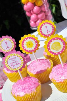 Pink and yellow cupcakes at a pink lemonade and sunshine birthday party! See more party ideas at CatchMyParty.com!