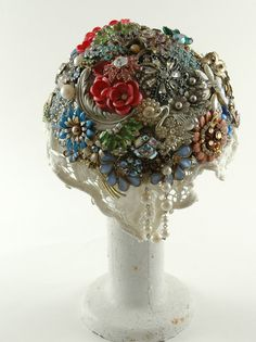 I absolutley LOVE this. And if I ever get married, I may have a vintage brooch bouquet. You can pick any colors you want and styles that you want. A great way for the bridesmaids to help with the design and style of your own bouquet that you can keep forever! Maybe even pass down in generations.