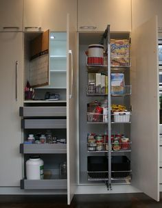 Kitchen - Cabinetry with pull out pantry.  'Secret' compartment behind cork board, pull out drawers with telephone/computer hook ups (mini office)....LED light turns on as cabinet door is opened....it's all in the details!    Interior Design ~ Lissee Interiors..