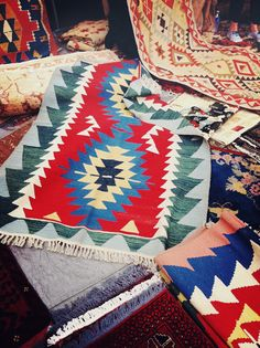 Southwestern inspired rugs. Thinking of placing one of these in a living room, for a splash of flare.