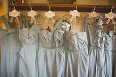 Pretty gray bridesmaid dresses with ruffles and varied cuts.