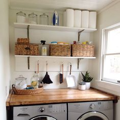 This room is clean and simple with the stream-lined shelving and gorgeous wood shelf above the washer and dryer units. To me this leans towards a more modern almost Scandinavian type feel. Garage Laundry Rooms, Rustic Laundry Rooms, Laundry Room Shelves, Laundry Closet, Small Laundry Rooms, Laundry Room Organization, Laundry Room Design, Laundry Area, Mud Rooms