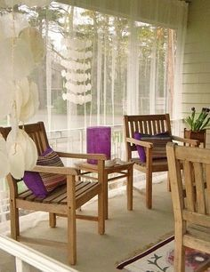 IKEA mosquito netting curtains for front porch--they also make the hanging wire.: