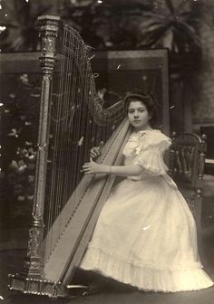 Ada Sassoli with a Gothic styled harp. 1903. (Source: State Library of Victoria.)