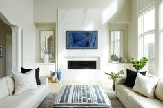Modern marble fireplace with built ins on each side, linear fireplace with Samsung Frame TV by Jillian Lare Des Moines Interior Designer Light Grey Paint Colors, Wall Paint Colors, Paint Colors For Living Room, Paint Colors For Home, House Colors, Neutral Paint, Room Colors, Linear Fireplace, Fireplace Built Ins