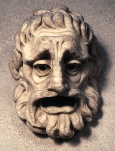 Marble tragic mask with beard. Culture/period      Roman term details  Materials      marble  Dimensions      Height: 21.5 centimetres  Bibliography      Sculpture 2452 bibliographic details