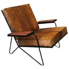 Sculptural Iron and Cowhide Lounge Chair After Raoul Guys | From a unique collection of antique and modern lounge chairs at https://www.1stdibs.com/furniture/seating/lounge-chairs/