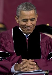 President Barack Obama smiles during prayer at the Morehouse College Sunday, May 19, 2013, in Atlanta. (AP Photo/Carolyn Kaster)