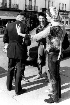 Sid Vicious and Steve Jones mock policeman
