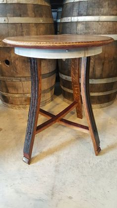 WINE BARREL END TABLES This beautiful table is hand-crafted from used solid oak wine barrel staves. The inside of the barrel was fluted which adds to the rich color and beauty of the legs. The top is made from a wine barrel head, sanded to perfection, stained and sealed to last for