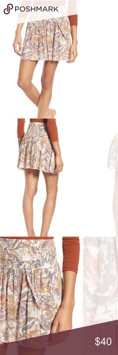 Smocked Waist Skirt NWOT Print smocked waist mini skirt. Very comfortable! New without tags.                        •n o  t r a d e s• •s m o k e  f r e e / p e t  f r e e  h o m e•   •s a m e / n e x t  d a y  s h i p p i n g• Skirts Mini