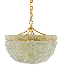 Clusters of tumbled Seaglass cast an enchanting glow, filling rooms with an aura of peacefulness. The misty aqua tones of the glass embellishments pair beautifully with a simple Contemporary Gold Leaf