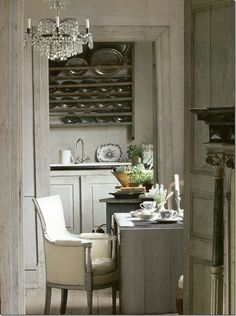 Gray tones, chandelier, old tin plates.