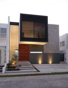 The exterior is the face of the house that everyone will see in the first part. Take a look at the world's most beautiful modern homes and find Modern House Facades, Modern Architecture House, Modern House Plans, Architecture Design, Modern Small House Design, Duplex House Design, House Front Design, Facade Design, Exterior Design