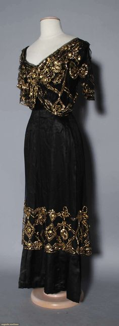 BLACK & GOLD EVENING GOWN, 1910 Black silk & net w/ gold beads & sequins