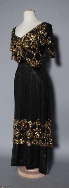 BLACK & GOLD EVENING GOWN, 1910 Black silk & net w/ gold beads & sequins