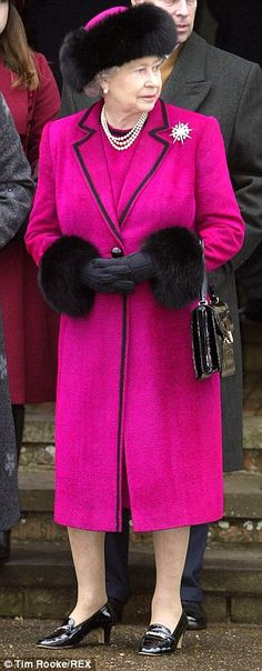 2002: Co-ordinating with the black fur trim on this fuchsia pink coat on Christmas Day