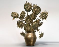 3D printed bronze realization of van gogh's sunflowers.Join the 3D Printing Conversation: http://www.fuelyourproductdesign.com/