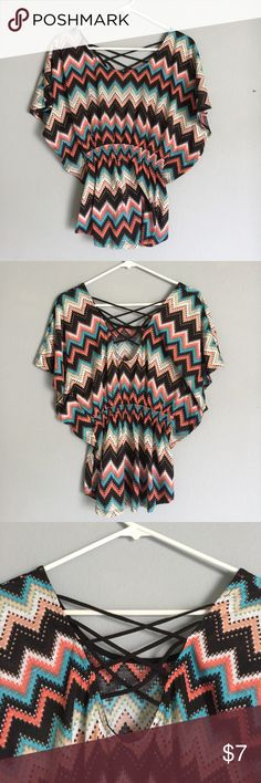 Super Cute Multi Colored Aztec Print Blouse Love this! Worn once. Perfect condition. Zig zag open back. Black/Pink/Cream/White/Blue. Chevron like design No Boundaries Tops Blouses