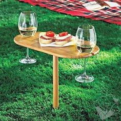 Great idea for beside the firepit. Stake your claim to enjoying wine or champagne outdoors! Just find a penetrable surface (grass, sand, dirt) to insert the post of this portable wine table. Slide two stemmed glasses into the side slots. Made of durable, finished bamboo, its sturdy enough to hold your glasses in place and support any tasty morsels you bring along. Conveniently stores flat.