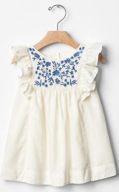 Blue embroidered dress with white cap sleeves.