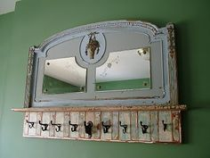 Bryan Appleton Designs: This is an old bed end, bought at Alameda. I had these old mirrors, they seemed to fit nicely, and I built a coatrack out them. I loved the color of the bed piece, especially the basket of flowers. (looks hand painted) Antique cast-iron hooks on old beadboard complete the piece.