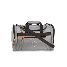 Just right for your destination wedding groomsman gifts, these Personalized Weekender Bags can be customized for each of your groomsmen with their own embroidered monograms. The personalized groomsman bags are constructed from durable polyester featuring metal hardware, leatherette pull-tabs, two zippered pockets, and an adjustable removable shoulder strap. Available for purchase online at http://madelinesweddings.weddingstar.com/product/weekender-bag-grey