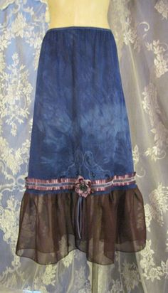 Long slip that has been upcycled into a fun skirt. Hand-dyed a marbled royal/cobalt with added wine colored chiffon around the bottom hem. Additional
