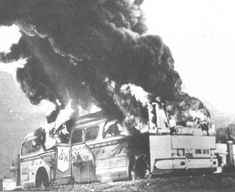 Organized by CORE, two integrated groups of Freedom Riders enter Alabama on May 14, 1961. One bus is ambushed and burned by a racist mob outside of Anniston.