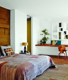 The master bedroom overlooks one of the oldest streets in Monnickendam. The Eames chair is from Herman Miller, and the custom headboard, ...