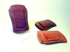 iPhone5とIDパスのケースです。前面に個性的なシェイプのパスポケット、背面にメダリオン。|ハンドメイド、手作り、手仕事品の通販・販売・購入ならCreema。