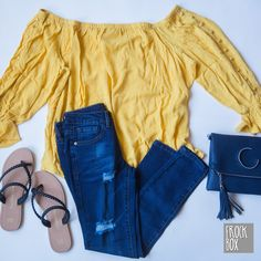 Yellow blouse with Distressed Denim for a casual look.