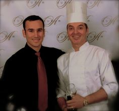 Maitre'D and Chef posing for pictures, prior to addressing the guests and then commencing their surprise singing waiter & chef show.