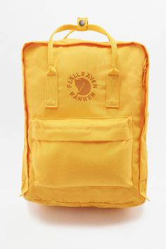 outlet store 42b9a 025ec Fjallraven Re-Kanken Sunflower Yellow Backpack  Urban Outfitters  Womens   Accessories  Bags