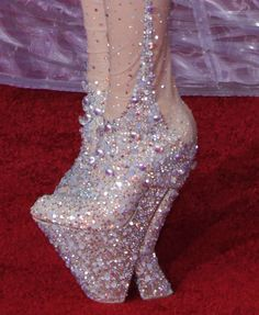 Lady Gaga's Grammy Shoes    Sparkles, gems and jewels, oh my! These solar-system themed heels definitely stood out as Lady Gaga strutted her stuff down the Grammy's red carpet. We have to give her props for making a fashion statement without losing her balance!