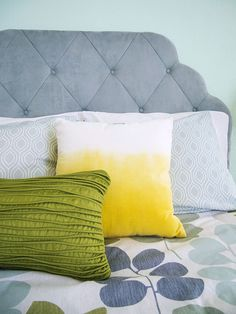 A simple bedroom with colourful pillow..