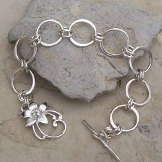 Handmade Sterling Silver Chain Bracelet with Sterling Silver Lily Toggle Clasp, via Etsy.