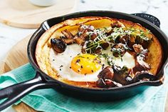 Dutch baby pancakes with fried eggs and mushrooms