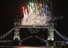 """Fireworks explode above the iconic Tower Bridge over the River Thames during the [London 2012 Olympics] Opening Ceremony."" Photo by Lefteris Pitarakis"