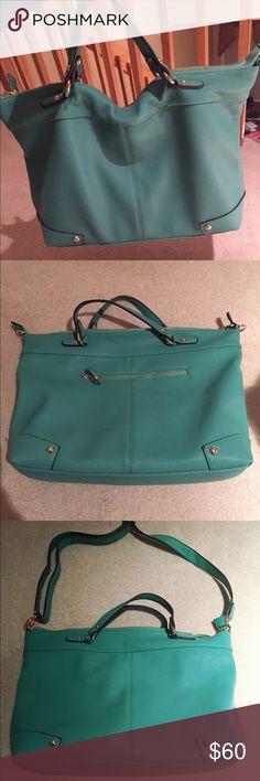 Mint handbag Good condition, NEVER USED! 2 ways handbag (tote/shoulder bag) Top zip closures  Interior cell phone pocket, interior laptop compartment and 2 interior zip pockets. Bags Totes