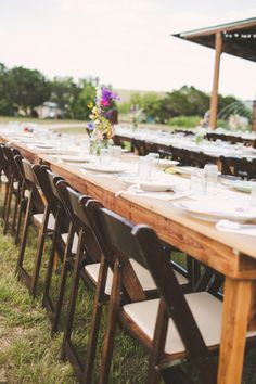long farm tables with simple picked floral centerpieces Photography by www.thelifeyoulovephotography.com  Read more - http://www.stylemepretty.com/2013/09/24/wimberley-texas-wedding-from-the-life-you-love-photography/