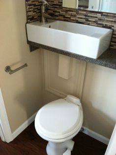 Bathroom sink above toilet to save space! Also could combine with the sink water recycle idea.