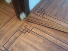 Love this greek key wood floor inlay. Could it be reproduced effectively with paint? Modern Flooring, Engineered Hardwood Flooring, Hardwood Floors, Flooring Types, Flooring Options, Flooring Ideas, Caitlin Wilson Design, Wood Floor Pattern, Painted Floors