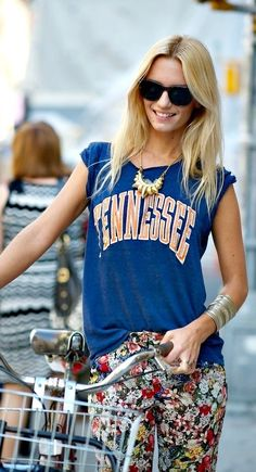 love love love, blue graphic tee shirt, floral patterned pants, gold bubble necklace