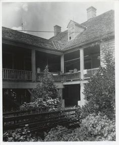 Riverlake Plantation :: Frances B. Johnston Photograph Collection Exterior view of rear entrance of French Creole style house, including garden.
